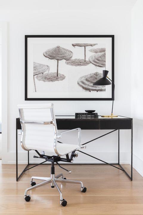 Wooden floors, black desk, white chair