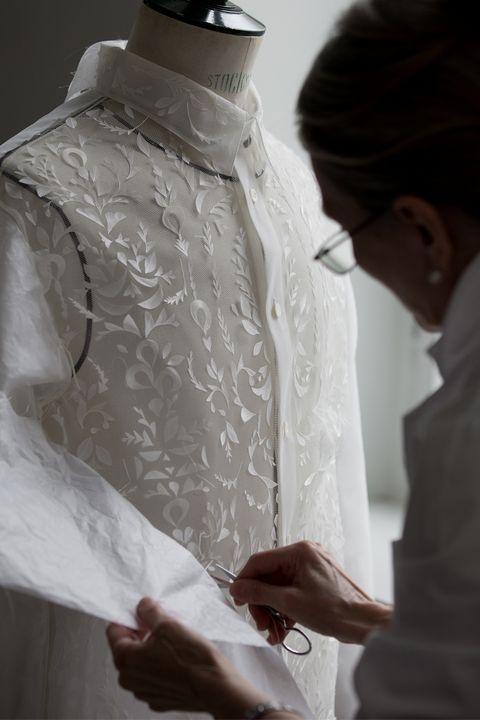 White, Clothing, Dress, Fashion, Formal wear, Shoulder, Fashion design, Outerwear, Suit, Hand,