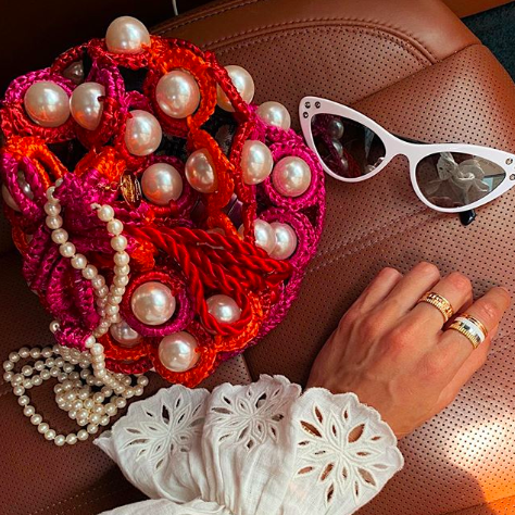Red, Eyewear, Pink, Hand, Pearl, Fashion accessory, Textile, Jewellery, Photography, Finger,