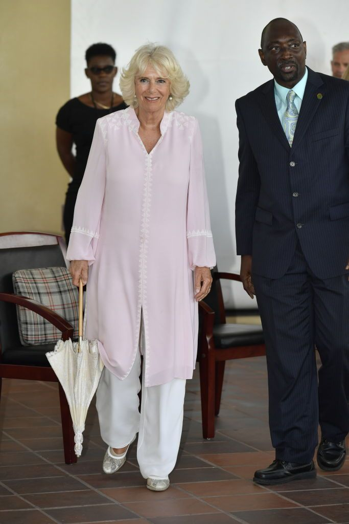Camilla wore an embroidered pink and white caftan with white pants, and pearl drop earrings for her visit to numerous organizations, such as the Grenadines Community College, while in St. Vincent and the Grenadines.