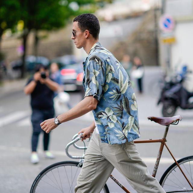 paris, france   june 20  a guest wears a floral print shirt, outside acne, during paris fashion week   menswear spring summer 2019, on june 20, 2018 in paris, france  photo by edward berthelotgetty images