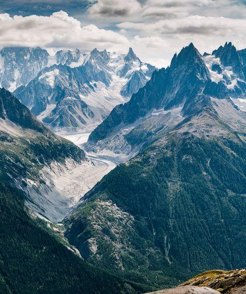 Mountainous landforms, Mountain, Mountain range, Highland, Sky, Natural landscape, Ridge, Alps, Valley, Wilderness,
