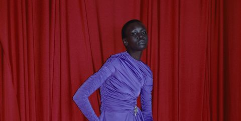 Sleeve, Human body, Shoulder, Textile, Joint, Red, Elbow, Interior design, Magenta, Wrist,