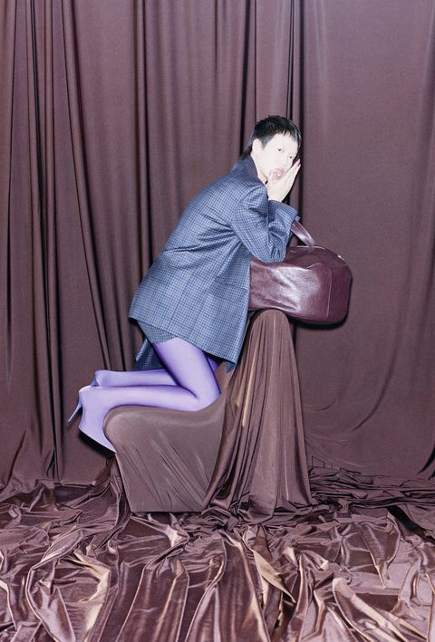 Human, Hairstyle, Human body, Textile, Sitting, Comfort, Purple, Curtain, Black hair, Lap,