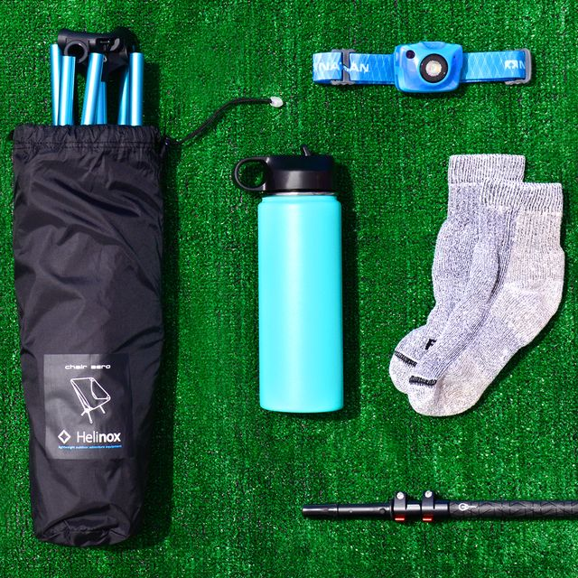 hiking boots, helinox camping chair, water bottle, headlamp, wool socks