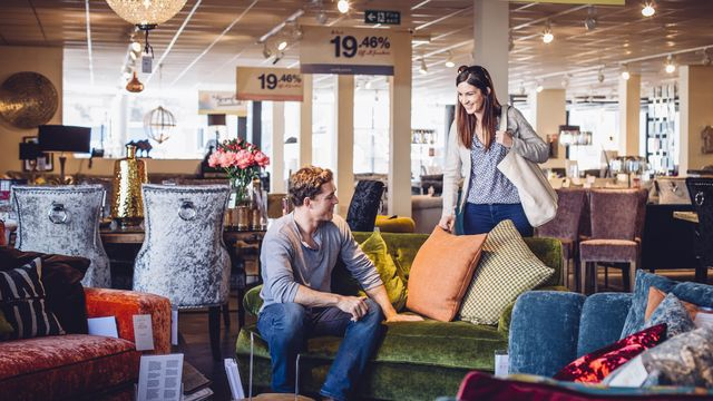 two people shopping at a furniture sale