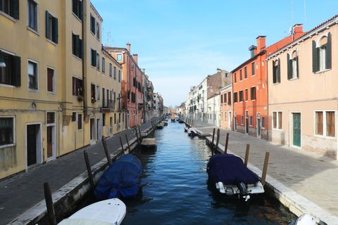 Why Are the Venice Canals Clear Again, showing clear water and colourful houses.