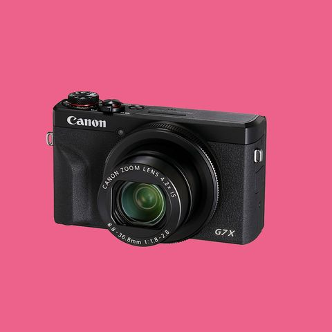 Camera, Digital camera, Cameras & optics, Camera lens, Point-and-shoot camera, Camera accessory, Mirrorless interchangeable-lens camera, Lens, Photograph, Product,