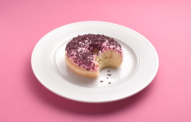 can't resist temptation bite out of doughnut