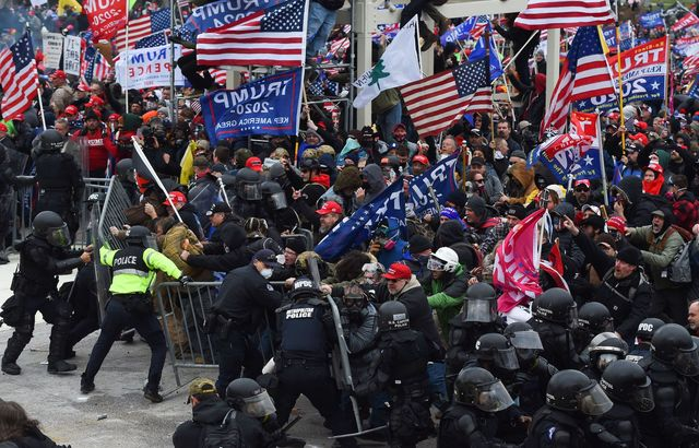 topshot   trump supporters clash with police and security forces as they push barricades to storm the us capitol in washington dc on january 6, 2021   demonstrators breeched security and entered the capitol as congress debated the a 2020 presidential election electoral vote certification photo by roberto schmidt  afp photo by roberto schmidtafp via getty images