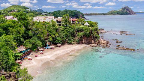 Body of water, Beach, Sea, Coast, Sky, Natural landscape, Vacation, Coastal and oceanic landforms, Shore, Tropics,