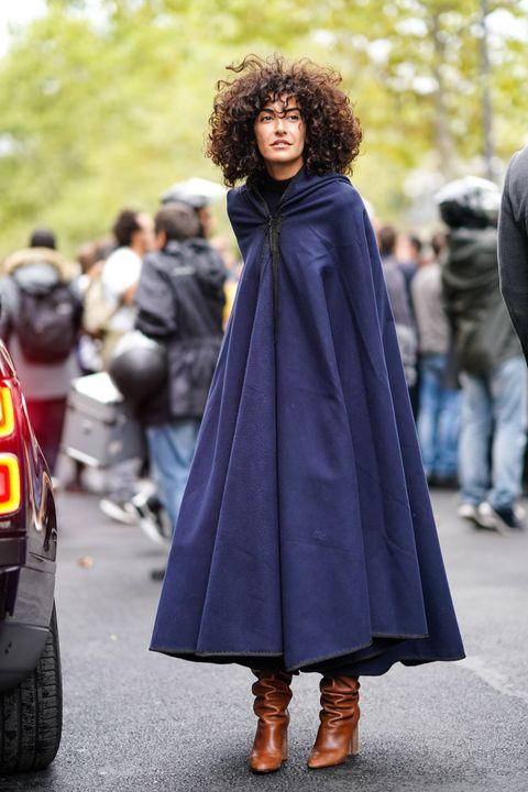 Clothing, Street fashion, Outerwear, Fashion, Hairstyle, Costume, Footwear, Cape, Cloak, Coat,