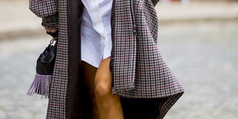 Clothing, Street fashion, White, Fashion, Outerwear, Pattern, Coat, Leg, Design, Footwear,