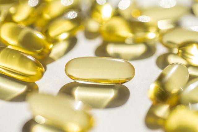 capsules of fish fat oil vitamin for heart, omega 3, macro
