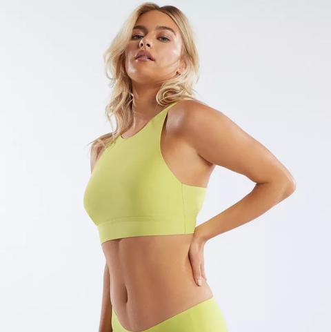 Clothing, Brassiere, Undergarment, Undergarment, Yellow, Sports bra, Shoulder, Waist, Neck, Crop top,