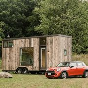 tiny homes with mini coopers in front of them