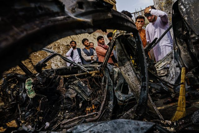kabul, afghanistan    august 30, 2021 relatives and neighbors of the ahmadi family gathered around the incinerated husk of a vehicle targeted and hit earlier sunday afternoon by an american drone strike, which killed 10 people including children, in kabul, afghanistan, monday, aug 30, 2021 marcus yam  los angeles times