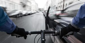 Car-dooring -- Cyclist in the rain on collision course with car door