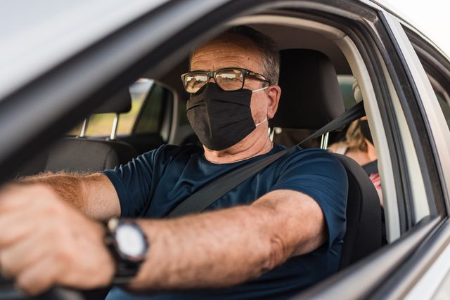car driver wearing protective mask