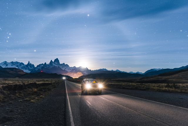 car driving at night on the road to el chalten, patagonia argentina