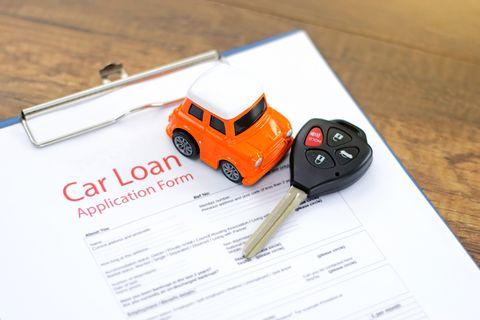 Car loan application with car keys and model car