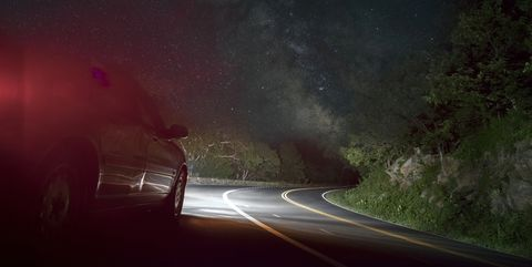Car On Winding Road Under Starry Sky