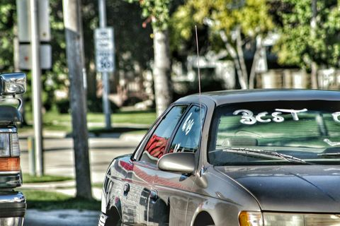 Car With Graffiti Text On Windshield