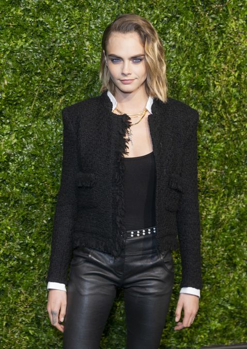 Cara Delevingne wearing Chanel attends the Chanel 14th...
