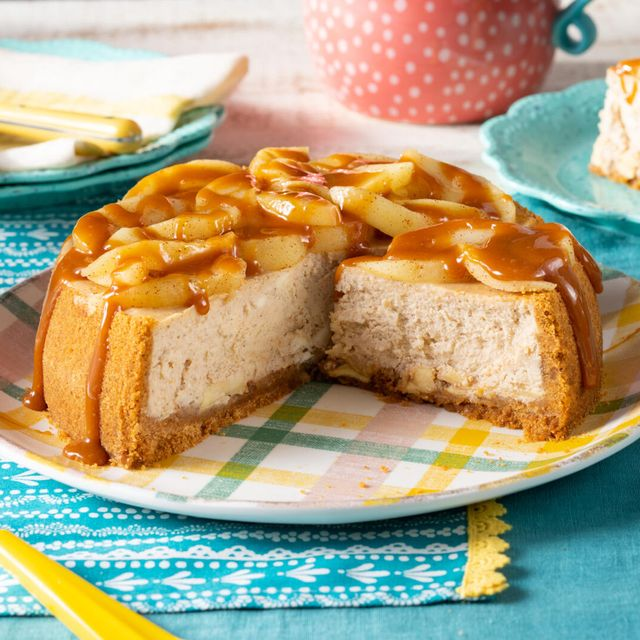 caramel apple cheesecake in a graham cracker crust with a layer of caramel apples then a brown sugar spiced cheesecake filling topped with more apples and caramel sauce