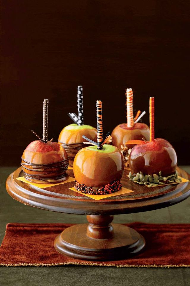 caramel apples on cake stand