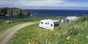 Trewethett Farm Caravan Club Site, Cornwall, England. Caravans with breathtaking views to the sea as the site boasts a cliff top setting, overlooking Bossiney Cove with its safe and sandy beach.
