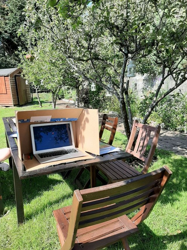 cardboard box with laptop inside outdoors