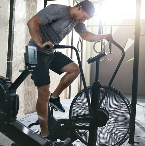 Cardio Workout. Sport  Man Training On Bicycle, Cycling Exercise