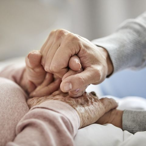caregiver supporting woman during corona outbreak