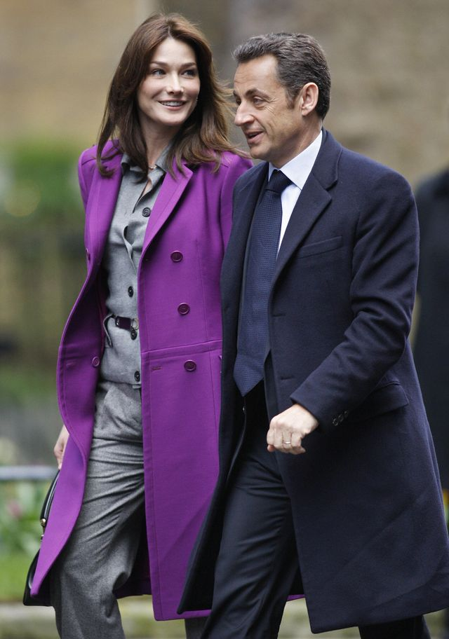 french president nicolas sarkozy r and his wife carla bruni sarkozy arrive for a meeting with british prime minister gordon brown at 10 downing street in london, march 27, 2008 carla bruni sarkozy, french president nicolas sarkozys new wife, dominated the british press on thursday, drawing comparisons to princess diana and jackie kennedy the former italian supermodel was pictured on the front page of nearly every major british paper, shown wearing an elegant grey christian dior outfit with matching beret afp photoadrian dennis photo credit should read adrian dennisafp via getty images