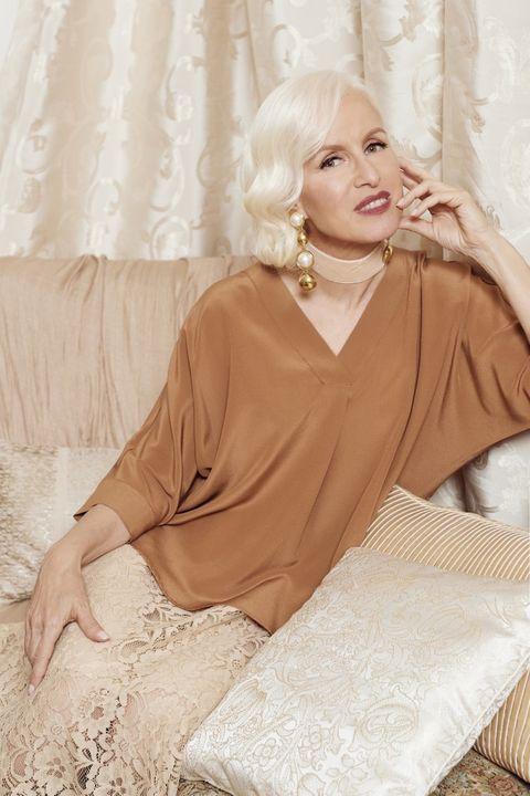 Clothing, Robe, Beige, Dress, Blond, Nightwear, Sitting, Outerwear, Silk, Long hair,