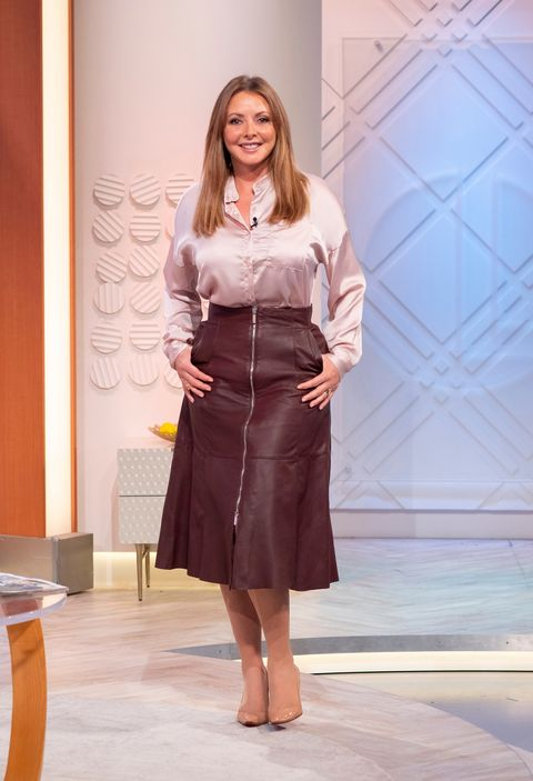 9ef416787e Carol Vorderman Wears Perfect Brown Leather Investment Skirt To ...