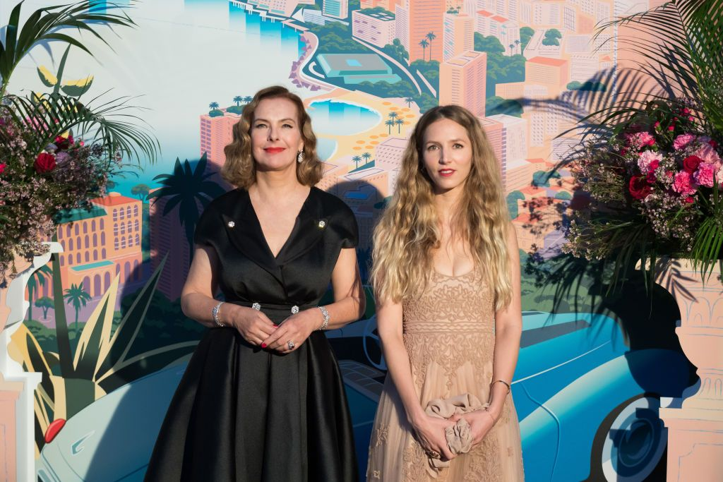 French actress Carole Bouquet, Dimitri Rassam's mother, and Charlotte Giacobetti arrive at the ball.