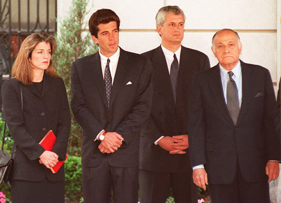 Jackie's children Caroline Kennedy Schlossberg and John F. Kennedy Jr. pictured here on the day of her funeral with Caroline's husband Edwin Scholssberg and Maurice Tempelsman. After the services, her body was taken from New York City and laid to rest in Arlington National Cemetery next to graves of President Kennedy, their stillborn daughter, and the son they lost in infancy.