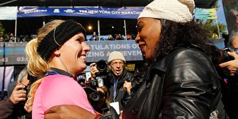 Caroline Wozniacki hugs Serena Williams after the 2014 New York City Marathon