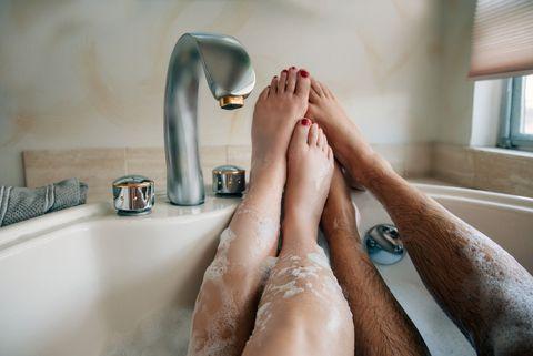 Skin, Leg, Bathtub, Human leg, Beauty, Hand, Plumbing fixture, Bathroom, Bathing, Room,