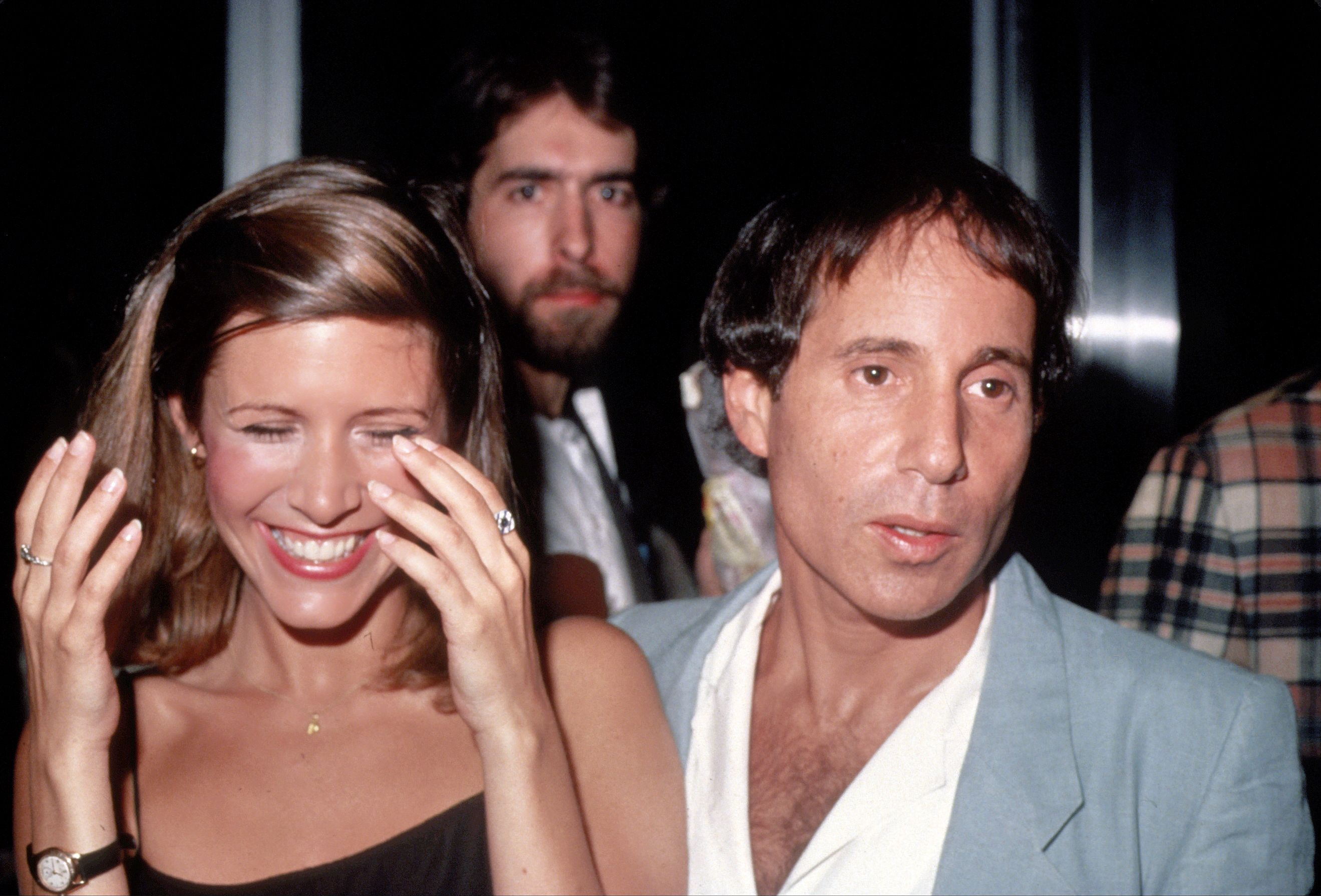 Paul Simon and Carrie Fisher in New York City in 1983, the year the couple married and the year Simon's D-Core masterpiece Hearts & Bones came out. Simon and Fisher had a turbulent relationship that ended in divorce a year later.