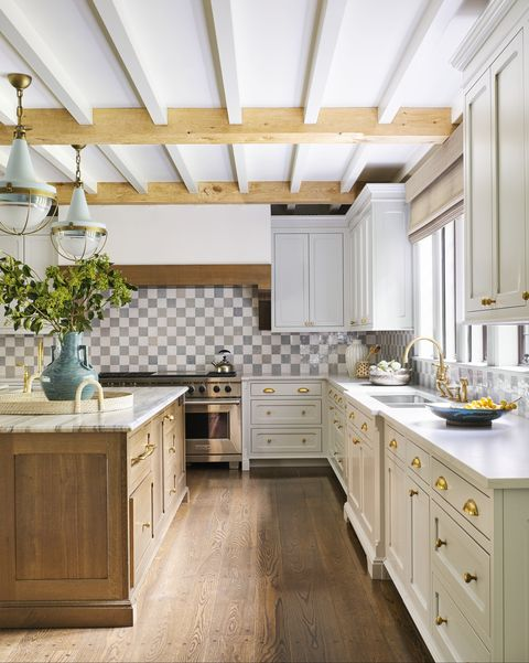 the kitchen's chic checkerboard backsplash is fashioned out of glazed terra cotta tile