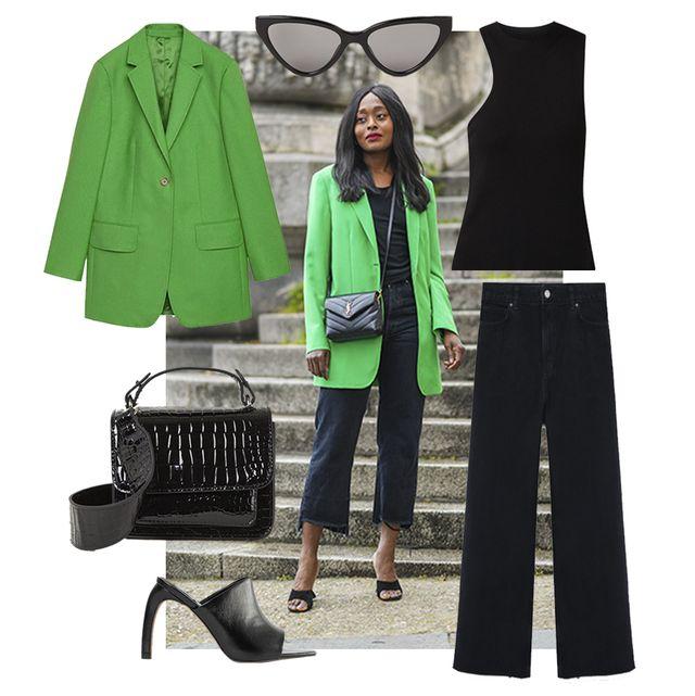 carrole sagba draagt zwarte outfit en groene blazer