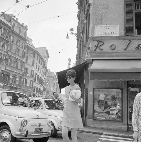 Audrey Hepburn Crossing Street Near Automobiles