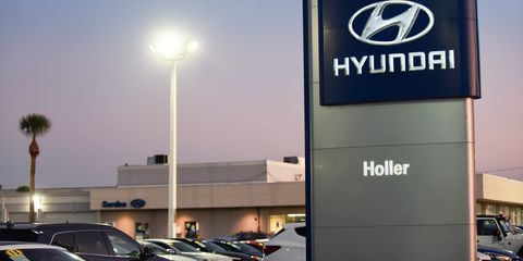 Cars are seen at a Hyundai car dealership.  Hyundai and Kia...
