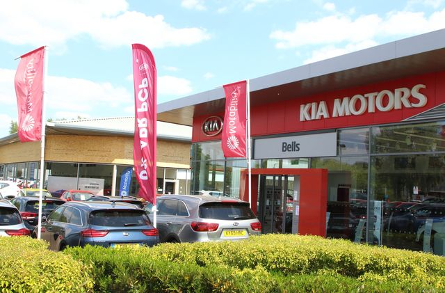 cars are seen parked outside the forecourt of bells as kia