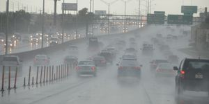 Cars Moving On Highway During Heavy Rain