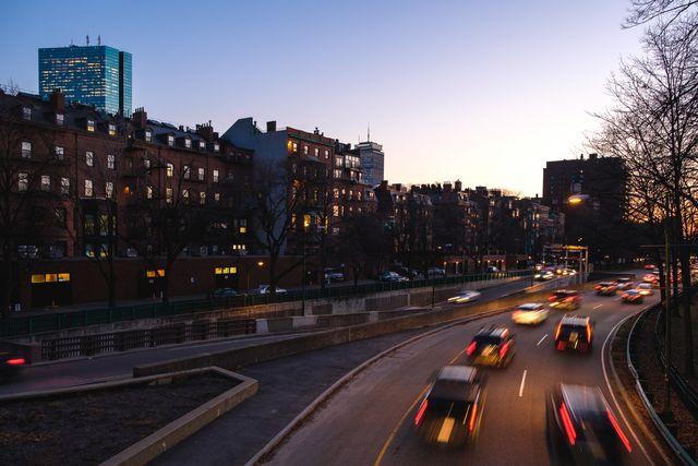 cars on street at dusk