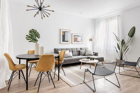 un piso de 45 m2 salón comedor en blanco, gris y negro